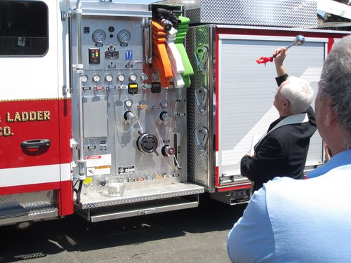 Father Manning pastor of Holy Cross Rumson blesses Sea Bright's new Ladder Truck