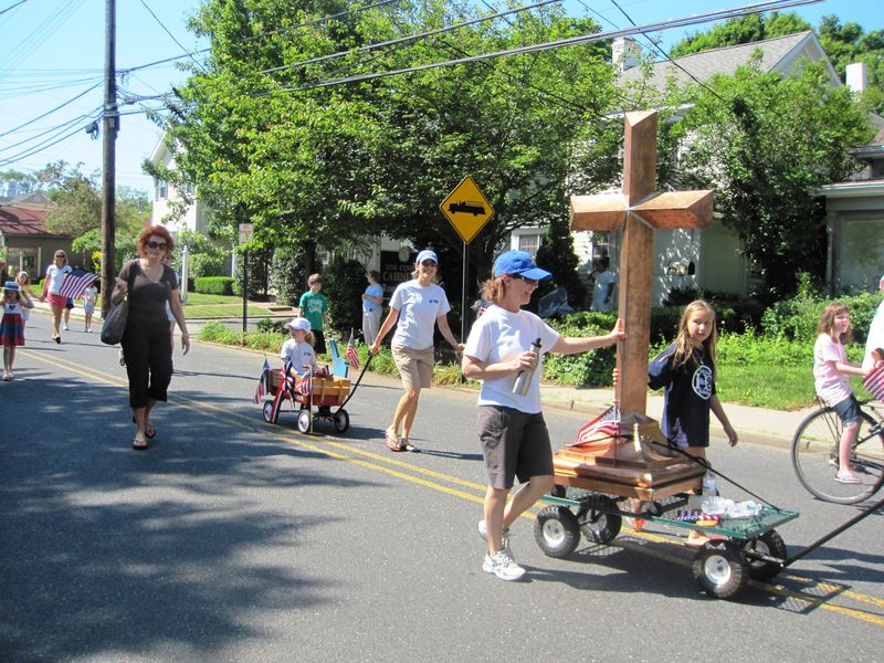 The old cross from Holy Rosary is processed in the Memorial Day Parade