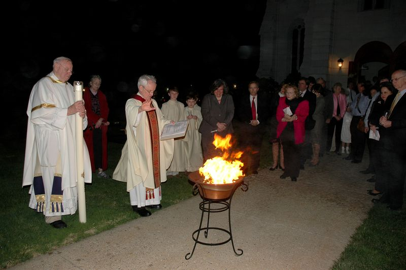 Priest blesses New Fire at the Easter Vigil