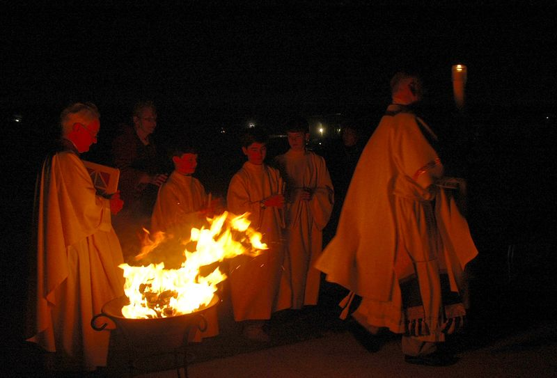 The Newly Lit Easter Candle is Carried into the Church by the Deacon