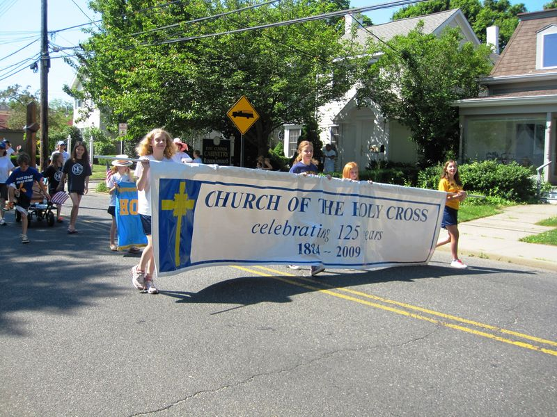 Holy Cross Anniversary Banner leads the Holy Cross contingent at the Memorial Day Parade